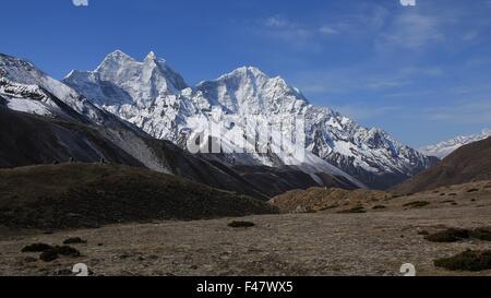 Snow capped mountains Kangtega and Thamserku - Stock Photo