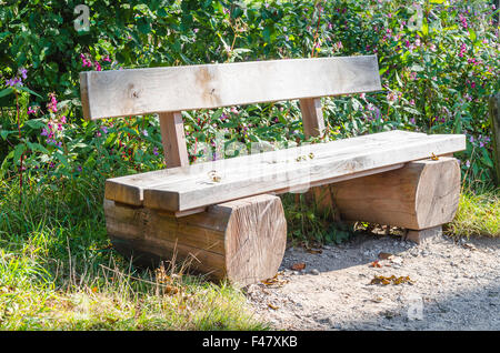 Bench, park bench made of tree trunk - Stock Photo