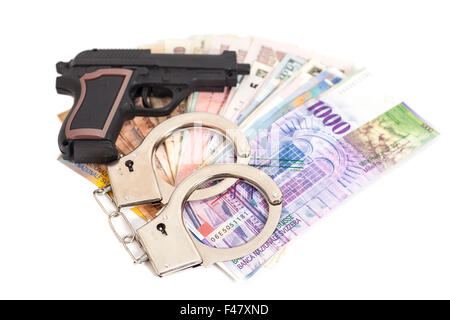 Gun, handcuffs and money isolated on white background - Stock Photo