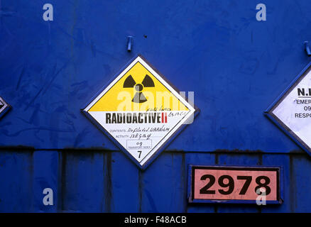 Radiation warning symbol on the back of a lorry carrying drums of depleted uranium. - Stock Photo