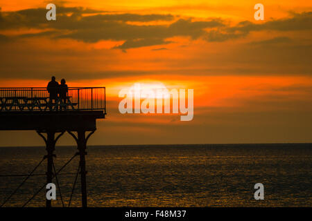 Aberystwyth Wales UK Thursday 15 October 2015  UK Weather: A couple stand in silhouette on the end of Aberystwyth - Stock Photo