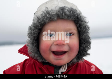 Portrait of a small boy in the winter, Sweden. - Stock Photo