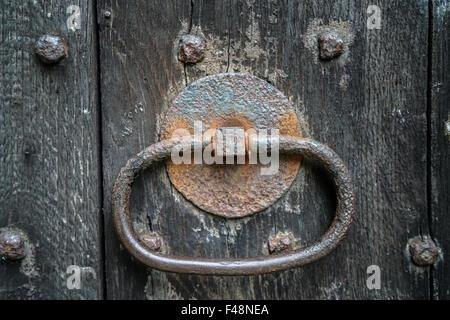 Old church handle/knocker in oak door. - Stock Photo