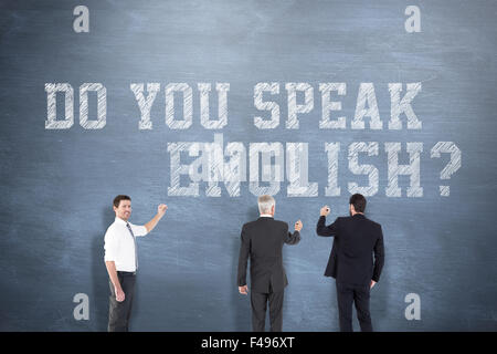 Composite image of business team writing - Stock Photo