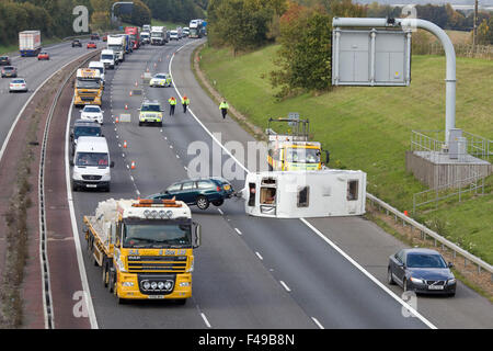 Overturned Caravan on the M40 Oxfordshire, road traffic accident on the motorway causing a traffic jam - Stock Photo