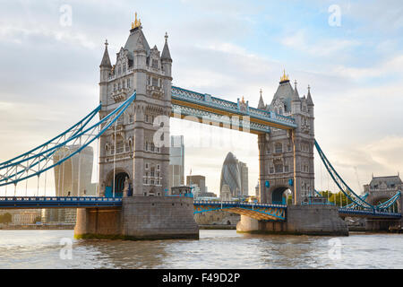Tower bridge in London in the afternoon sunlight with skyscrapers view - Stock Photo