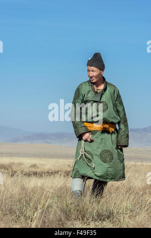 Portrait of a Mongolian goat herder on the steppes, near Hustai National Park, Mongolia - Stock Photo