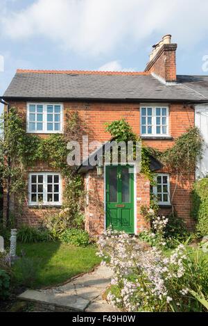Small semi-detached cottage, Chertsey Road, Windlesham, Surrey, England, United Kingdom - Stock Photo