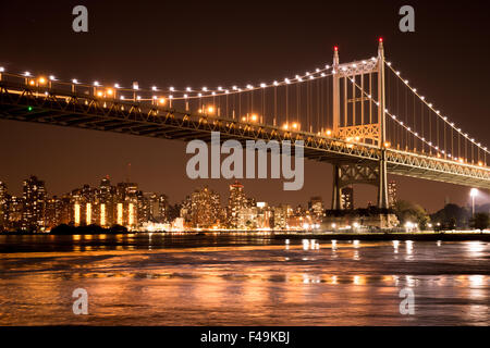 Beautiful view of the Ed Koch Queensboro Bridge in New York City looking towards Manhattan at night - Stock Photo