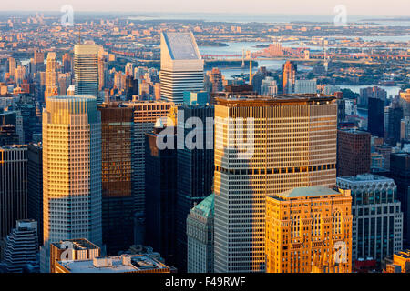 Aerial view of Midtown Manhattan skyscrapers at sunset. New York City skyline. USA - Stock Photo
