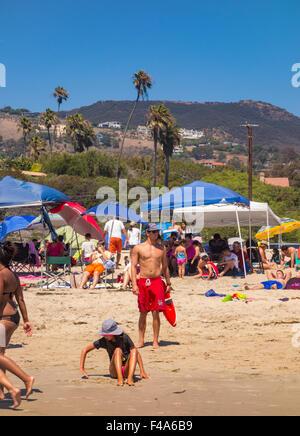 ZUMA BEACH, CALIFORNIA, USA - People on Zuma beach, public beach north of Malibu. - Stock Photo