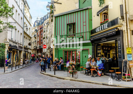 People relax at a café off the Seine. July, 2015. Paris, France. - Stock Photo