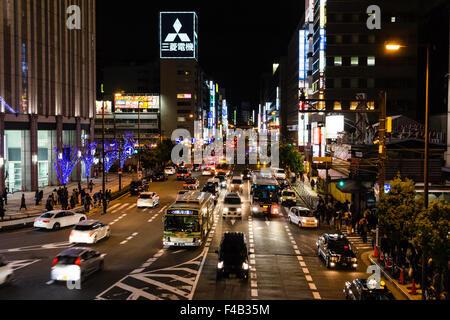 Osaka, Umeda at night. Traffic on six lane street outside the iconic Yodobashi camera and electronics store. View - Stock Photo