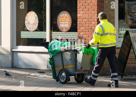 Street cleaner in High Street, Staines-upon-Thames, Surrey, England, United Kingdom - Stock Photo