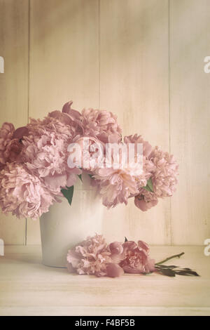 Peony flowers in vase with vintage colors - Stock Photo