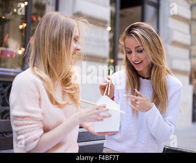 two friends enjoying lunch together - Stock Photo
