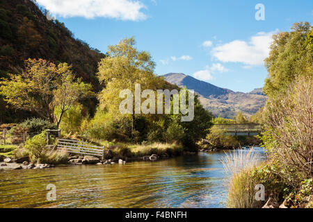 View to Moel Hebog along Afon Glaslyn River flowing out of Llyn Dinas lake in autumn in Nant Gwynant, Snowdonia National Park (Eryri), North Wales, UK