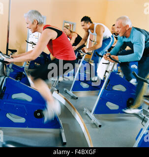 20-24 years 30-34 years activity adults only athlete bicycle bodybuilding color image cycle exercising five people - Stock Photo