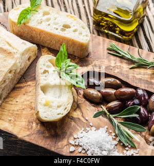 Ciabatta, olives and blue cheese on the wood. - Stock Photo