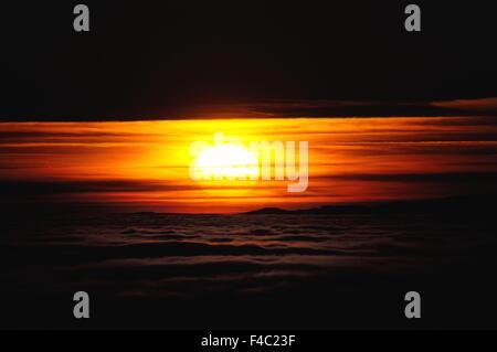 As the sun behind a curtain - Stock Photo