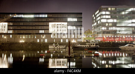 Duisburg Inner Harbour at night, Germany - Stock Photo