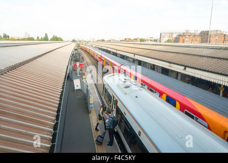 Trains on platform at Clapham Junction Railway Station, Battersea, London Borough of Wandsworth, London, England, - Stock Photo