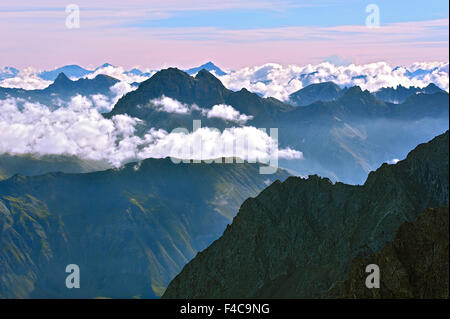 Panorama of the Alps in the morning, mountain tops over clouds, view from La Meije, region of the Ecrins, French - Stock Photo
