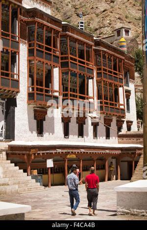 India, Jammu & Kashmir, Ladakh, Hemis Gompa Monastery visitors in courtyard - Stock Photo