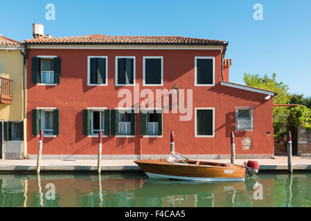 VENICE, ITALY CIRCA SEPTEMBER 2015: Typical Venetian house with boat used for transportation. - Stock Photo