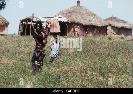 Senegal, St Louis, Mid Adult Woman with her three children in village (Large format sizes available) - Stock Photo