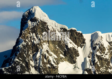 Antarctica, Setting sun lights mountain peaks on Ronge Island along Errera Channel. - Stock Photo