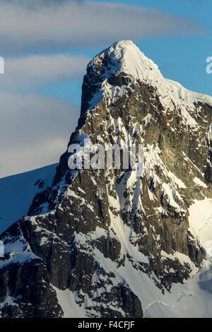 Antarctica, Setting sun lights mountain peaks on Ronge Island along Errera Channel. - Stock Photo