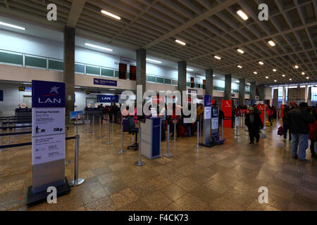 Passengers queuing at check in desks at Alejandro Velasco Astete International Airport, Cusco, Peru - Stock Photo