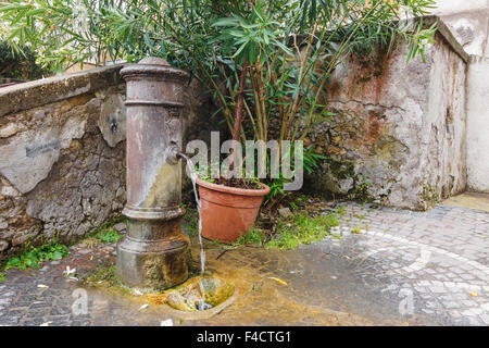 Typical nasone (cast iron fountain) in Rome, Italy - Stock Photo