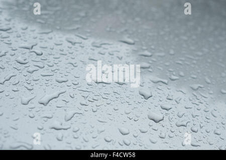 Waterdrops on a grey car paint - Stock Photo