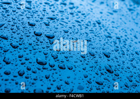 Waterdrops on blue car paint as underground - Stock Photo