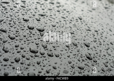 Waterdrops on black car paint as underground - Stock Photo