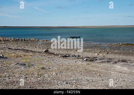Canada, Nunavut, western shore of Hudson Bay, Kivalliq Region, Arviat. Rocky shoreline along Hudson Bay. (Large - Stock Photo
