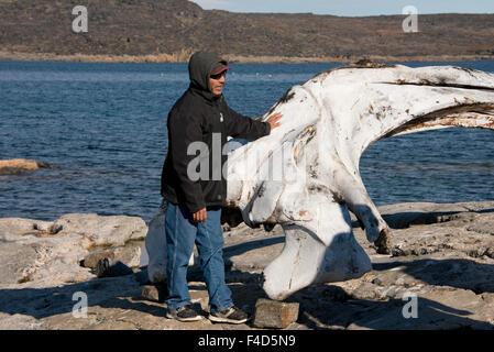 Canada, Nunavut, Qikiqtaaluk Region, Kekerten Island. Kekerten Historic Park, Bowhead whale jaw bone with Inuit - Stock Photo