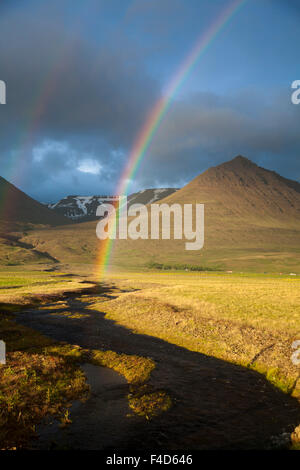 Evening rainbow over the Heradsvotn valley, Varmahlid, Skagafjordur, Nordhurland Vestra, Iceland. - Stock Photo