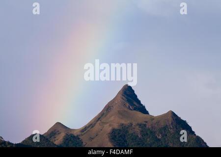 Rainbow over Cerro Orari, 560 m, near La Pintada in the Cocle province, Cordillera Central, Republic of Panama. - Stock Photo