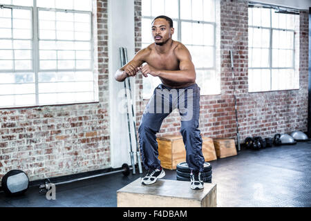 Fit man doing box jumps - Stock Photo