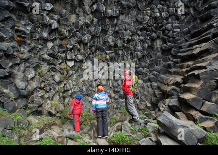 Family studying basalt rock formations at Hljodaklettar, Jokulsargljufur, Nordhurland Eystra, Iceland. - Stock Photo
