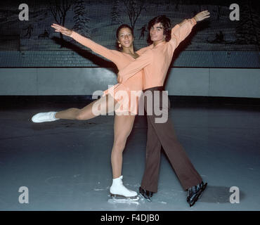 American teenagers Tai Babilonia, 18, and Randy Gardner, 19, practice their pair ice skating routines in 1977 at - Stock Photo