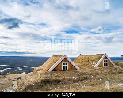 The old farm Sel with traditional turf roofing, now a Museum, in Vatnajokull NP during winter. To protect it from - Stock Photo