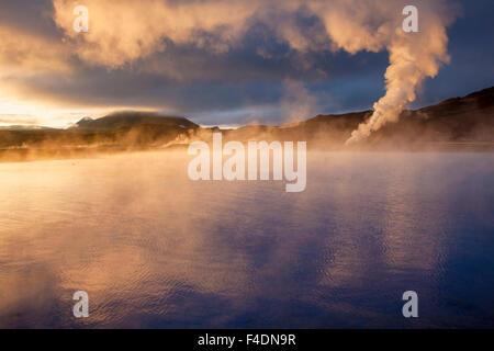 Sunset light on the streaming geothermal vents at Bjarnarflag, Myvatn, Nordhurland Eystra, Iceland. - Stock Photo
