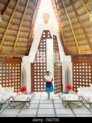 A Mexican staff member walks through the main spa entrance at Maroma Spa and Resort. Riviera Maya,Yucatan,Mexico. - Stock Photo
