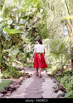 A staff member walk down a path at  Maroma Spa and Resort. Riviera Maya,Yucatan,Mexico. - Stock Photo