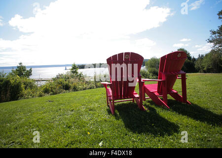 thebay furniture. A Pair Of Parks Canada Red Chairs Overlooking The Bay In Baddeck, N.S. - Stock Thebay Furniture