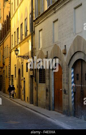 Late afternoon sun on a street in Florence italy - Stock Photo